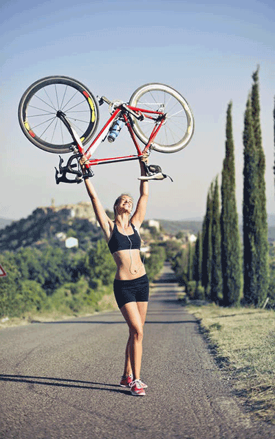 woman holding a road bike above her head