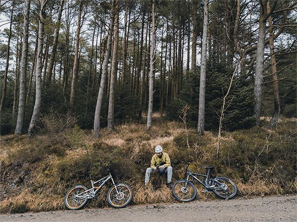 mountain biker with two bikes