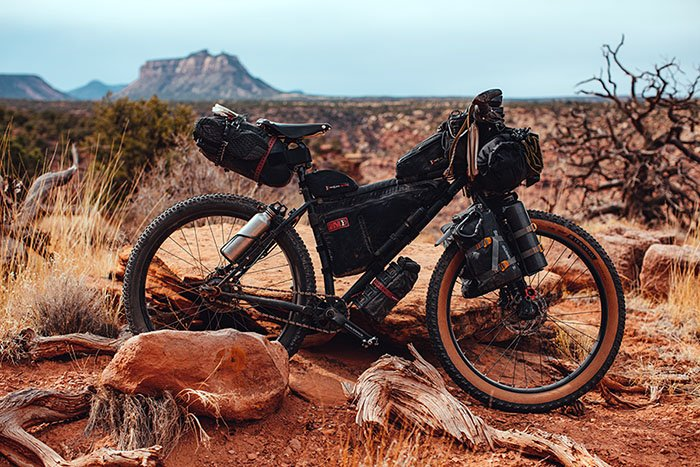 fully packed touring bicycle in the desert