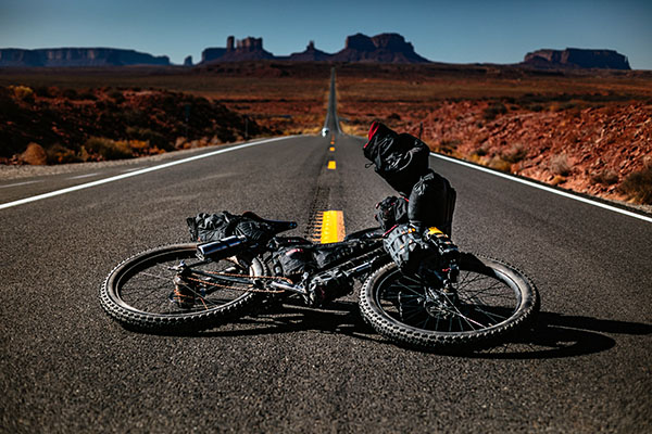 touring bike laying on the ground