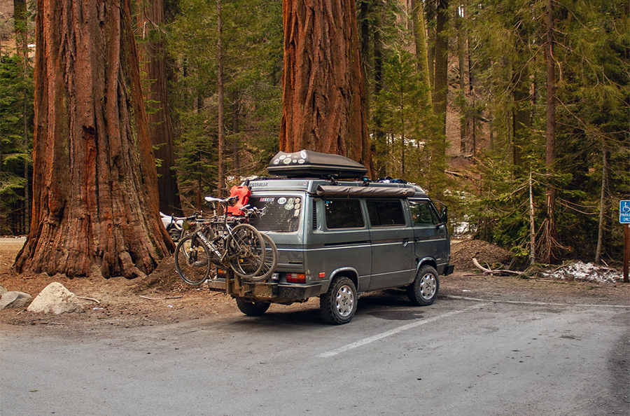 campervan with a bicycle in a national park