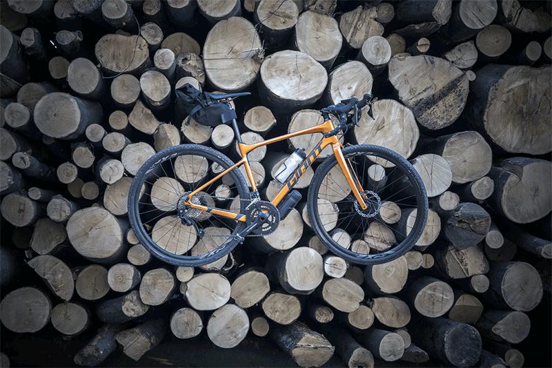 gravel bike on logs stack