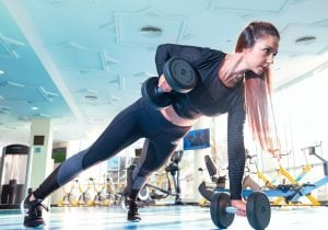 woman lifting weights for strength training