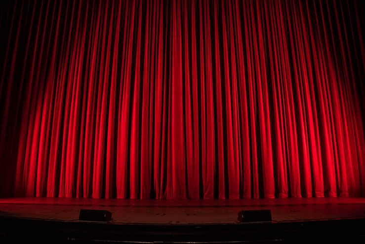 red stage curtains - unsplash photo credit