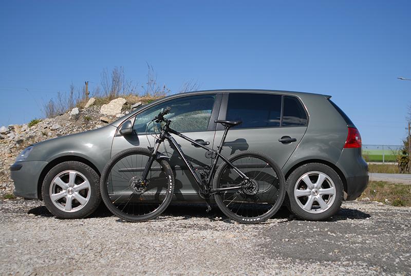 mountain bike by a car