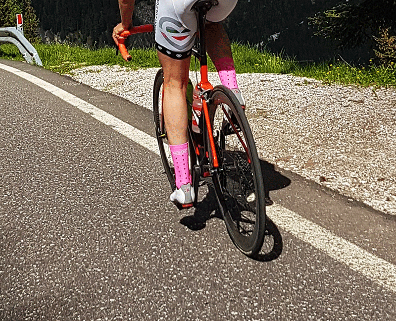 road biker with pink cycling socks