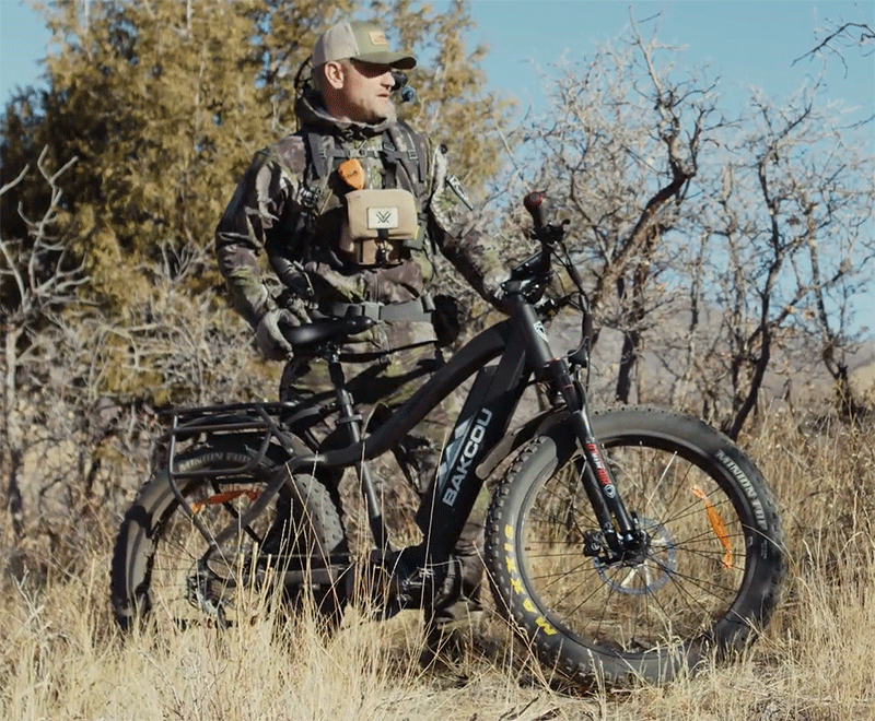 hunter stands next to the bakcou hunting bike